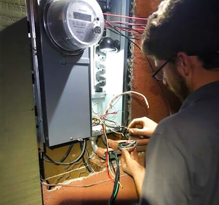 electrician measures wires